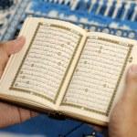 Young Man Reading The Holy Koran — Stock Photo #27461491