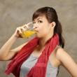 Woman drink orange juice after exercise — Stock Photo #33770331