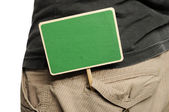 Wooden Sign On Male Pants — Stock Photo