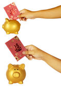 Insert Red Envelope Into Piggy Bank — Stock Photo