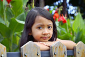 Little Girl Behind Wooden Fence — Fotografia Stock