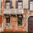 Scenic old houses along a canal in Venice, the lagoon of Italy — Stock Photo #43396239