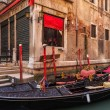 Beautiful gondola parked on the side of a small canal in Venice, Italy — Stock Photo #47312193