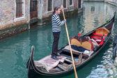 Gondola with driver, Venice, Italy — Stock Photo