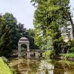 Постер, плакат: River bridge in the English garden of 17th century castle Dyck Germany