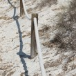 Elements of fence on the beach — Stock Photo