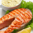 Stock Photo: Grilled salmon steak with sauce, parsley and lemon