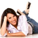 Woman lying on the floor — Stock Photo #12533911