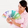 Woman holding a color scale guide  — Stockfoto