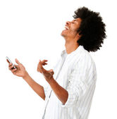 Afro man laughing with his cell — Stock Photo