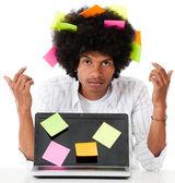 Black man multitasking — Stock Photo