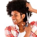 Black man cutting his afro — Stock Photo