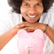 Stock Photo: Black mwith piggybank