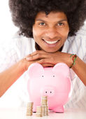 Black man with a piggybank — Stock Photo