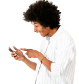 Man reading a funny text message — Stock Photo