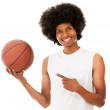 Basketball player holding the ball — Stock Photo