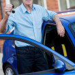 Man holding car keys — Stock Photo #12759427