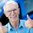 Stock Photo: Happy man with his car
