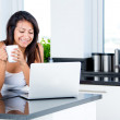 Woman checking emails in the morning - Foto Stock