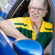 Senior man driving a car — Stockfoto