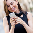 Businesswoman texting on her phone — Stock Photo