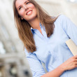 Business woman walking on the street — Stock Photo