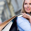 Stock Photo: Female shopper daydreaming