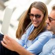 Couple on holidays with a laptop — Stockfoto #12784707