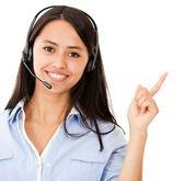 Vrouw met hoofdtelefoon wijzen — Stockfoto