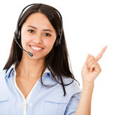 Woman with headset pointing — Stockfoto