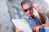 Happy couple sightseeing — Stock Photo
