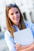 Female intern with a laptop — Stock Photo