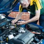 Man fixing a car engine — Stock Photo