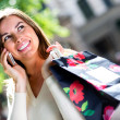 Shopping woman talking on her cell — Stock Photo