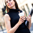 Business woman walking outdoors — Stock Photo
