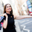 Shopping woman grabbing a taxi  — Stock Photo