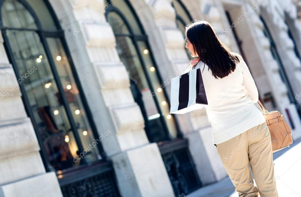 Woman walking on the street shopping and looking at windows  Stock Photo #12807887