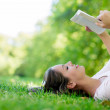 Woman enjoying a book — Stock Photo