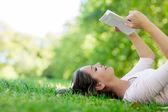 Woman enjoying a book — Stock Photo