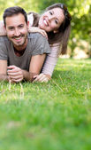 Playful couple smiling — Stock Photo