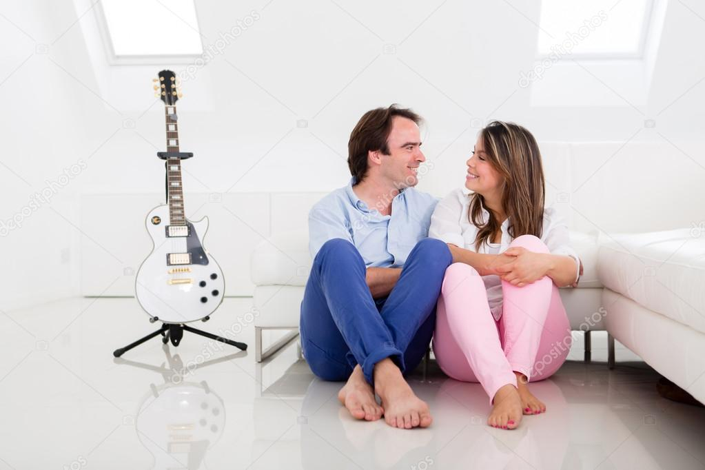 Couple of musicians at home with their guitar  — Stock Photo #12828461