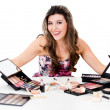 Woman with a bunch of make up — Stock Photo #12889105
