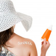 Summer woman wearing sunblock - Stock Photo