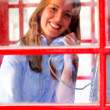 British woman talking on the phone - Stock Photo