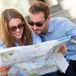 Tourists looking at map — Stock Photo #12889134