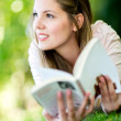 Thoughtful woman reading a book — Stock Photo #12889141