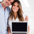 Couple holding a laptop — Stock Photo
