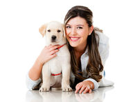 Girl with her puppy — Stock Photo