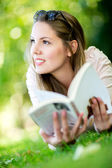Thoughtful woman reading a book — Stock Photo
