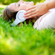 Woman listening to music - Foto Stock